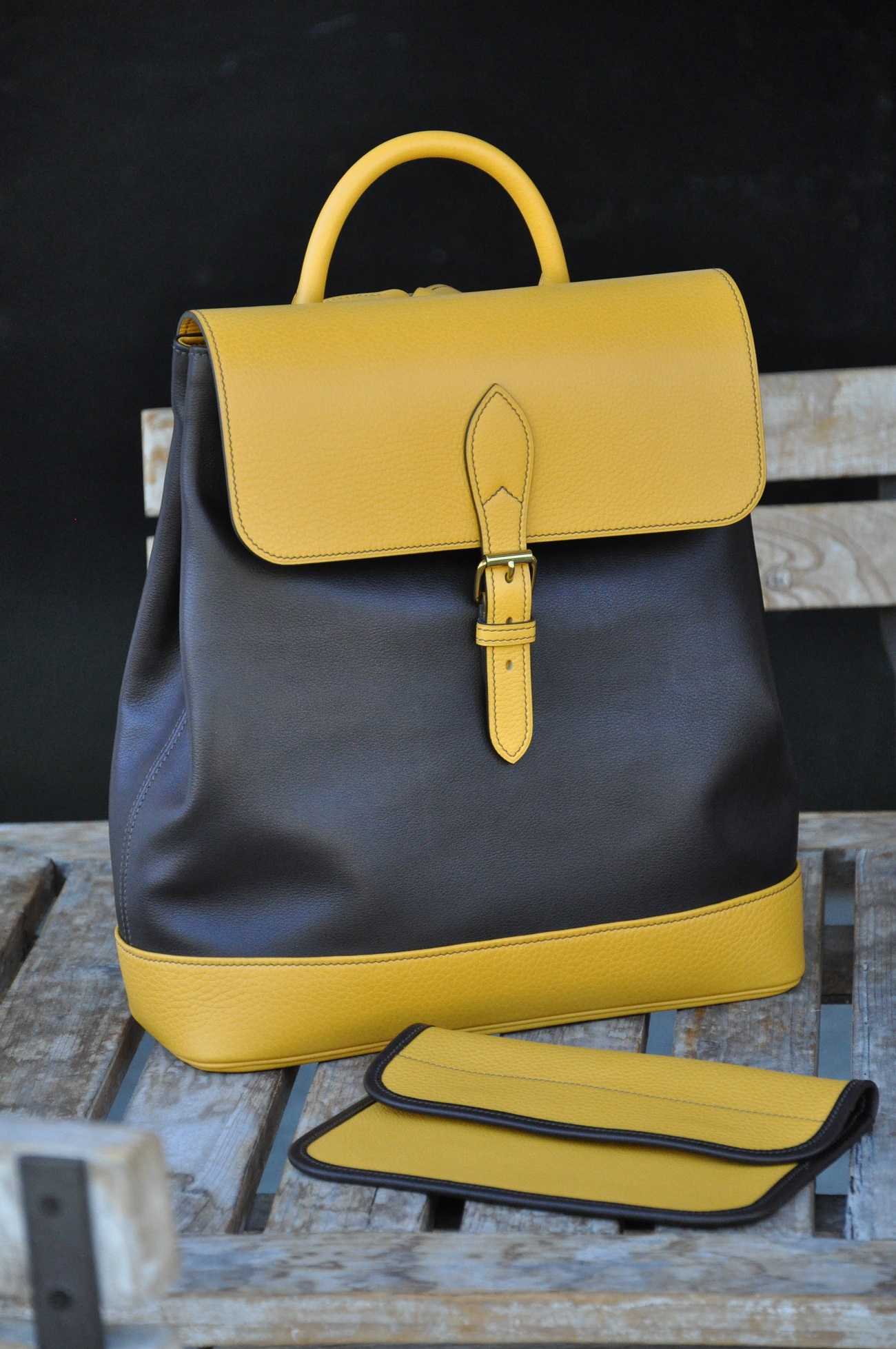 This back bag is made in yellow sunflower taurillon and brown calfskin, lined with brown cotton. It's a special order with his clutch bag. French savoir-faire by LE NOËN luxury leather goods craftsmen.