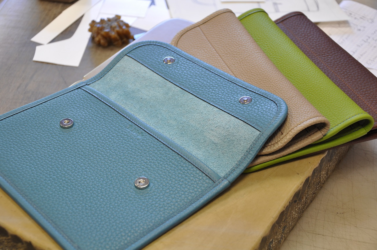 Clutch bags in taurillon, made by LE NOËN leather goods.